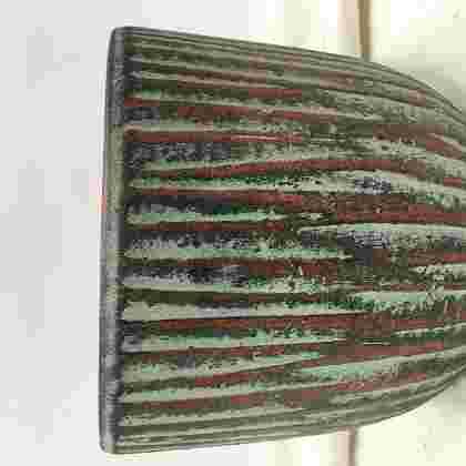 Norman pot round l. green